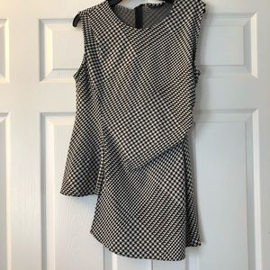 Asymmetrical houndstooth sleeveless blouse